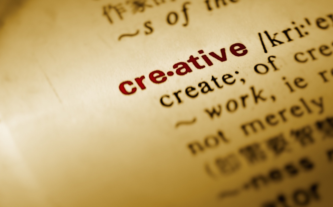 "Close-up of the word ""creative"" listed in a dictionary, photo by Elwynn"