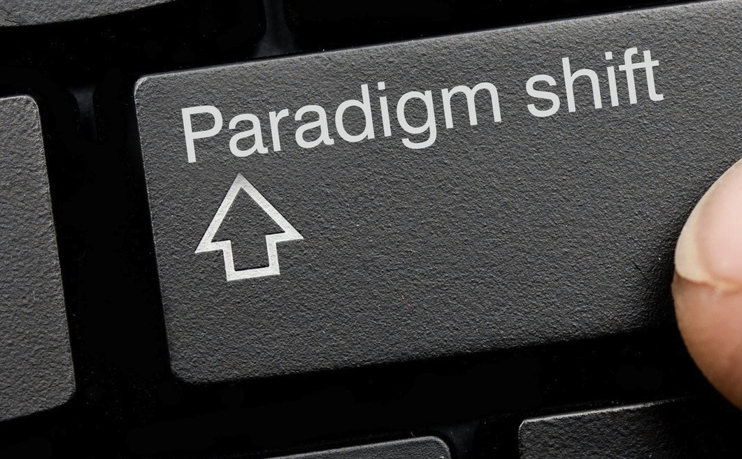 "Computer key that reads ""paradigm shift"" in place of the standard shift key, photo by Bradcalkins"