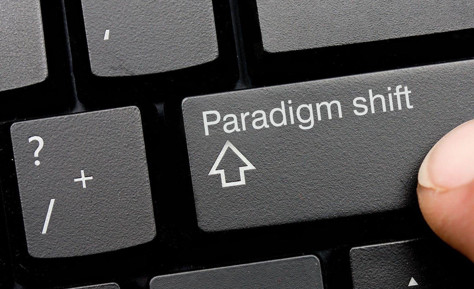 "Computer key reads ""paradigm shift"" in place of the standard shift key, photo by Bradcalkins"